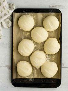 fully risen rolls on baking sheet