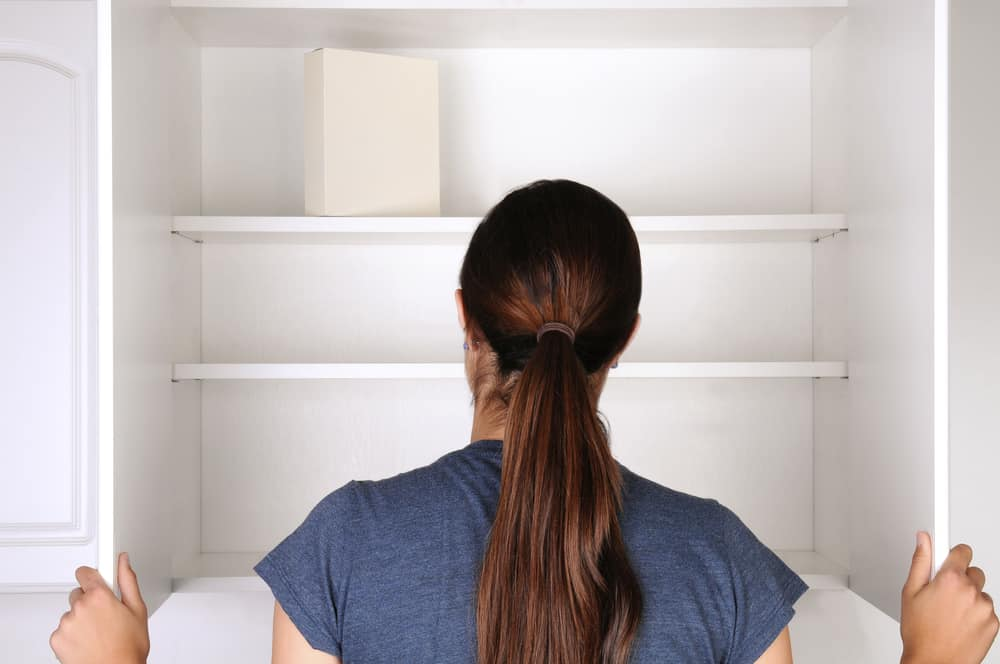 women looking into empty pantry