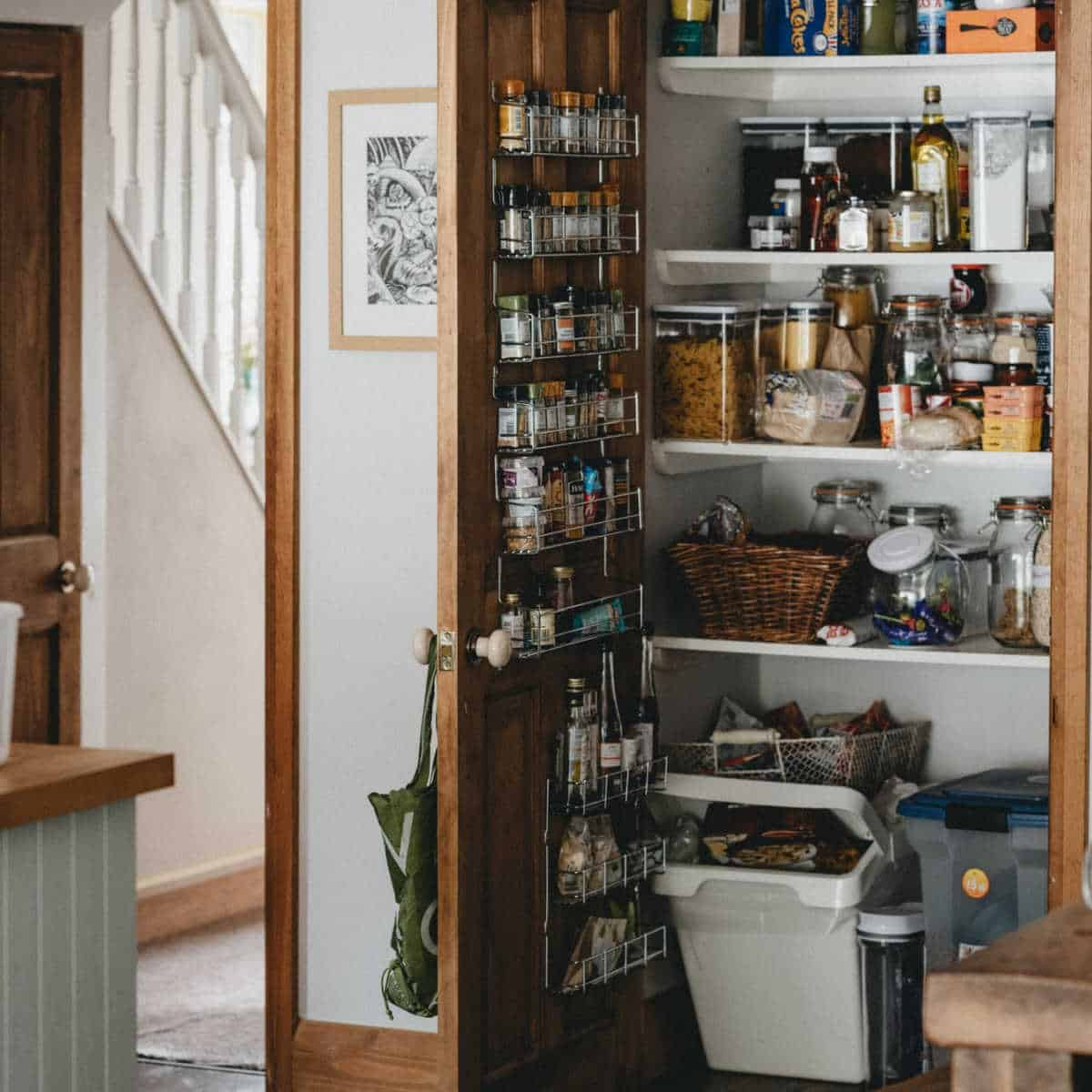 kitchen pantry with various bins and organizers for food