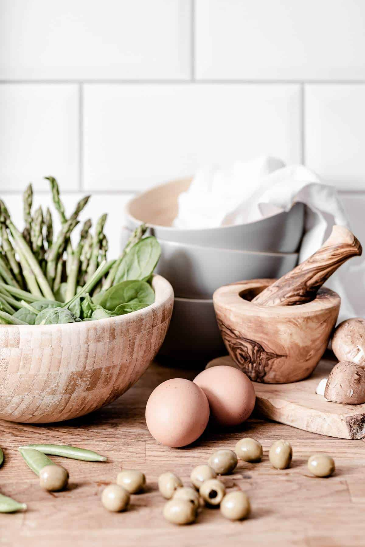home kitchen with bowls and veggies