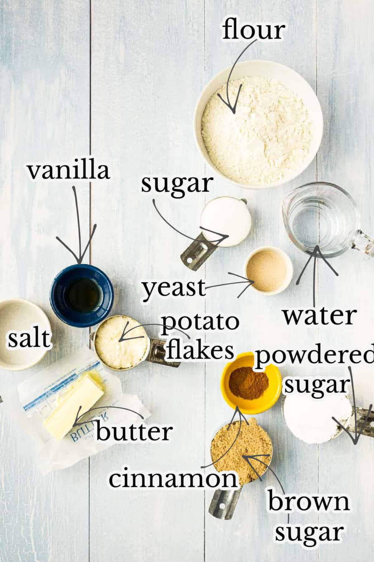 flour, sugar, vanilla, yeast, cinnamon, and other ingredients in small bowls