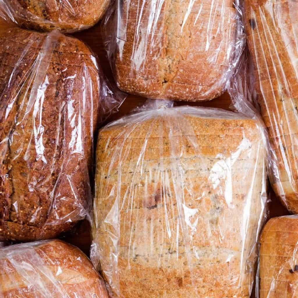 loaves of bread in clear plastic bags