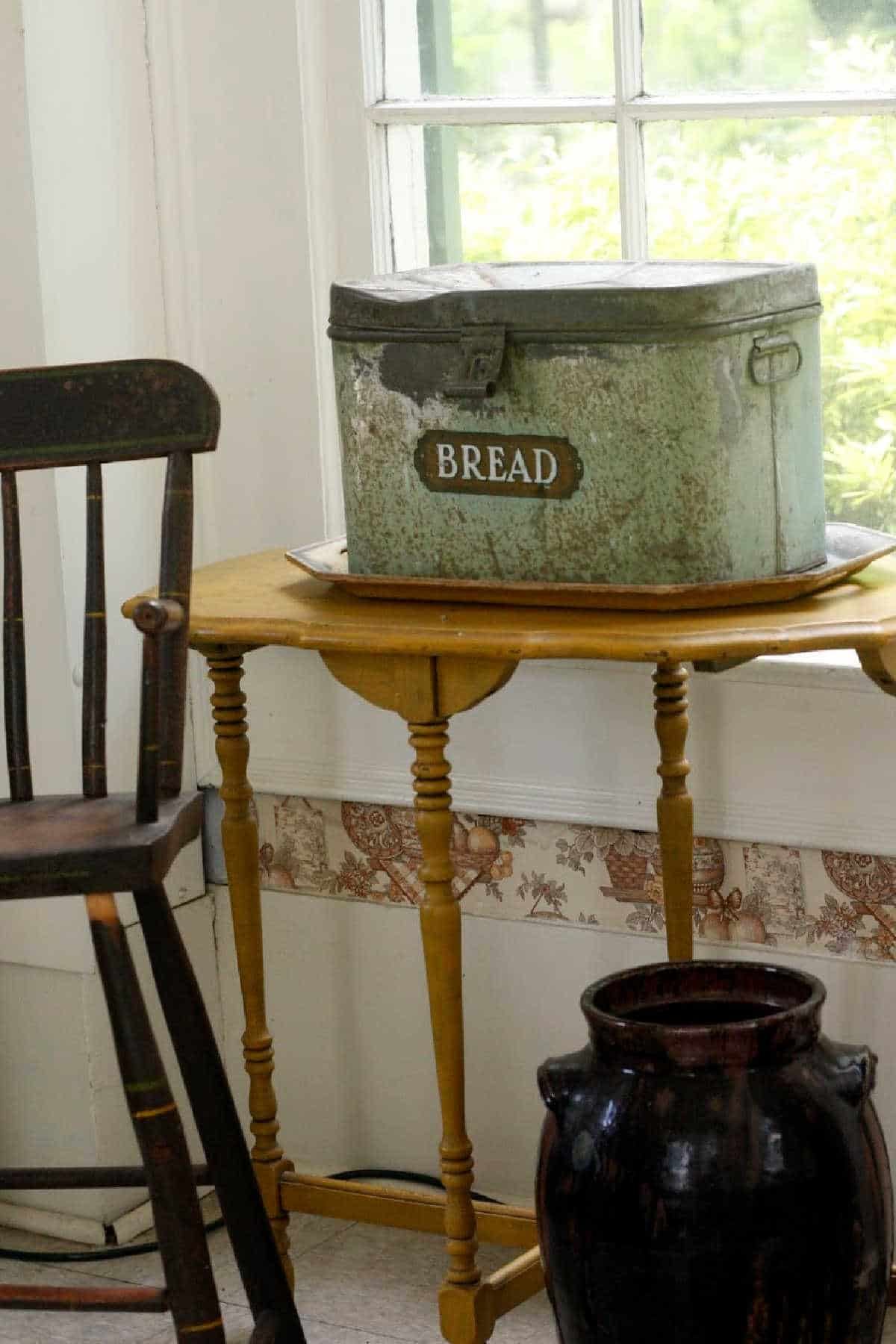 kitchen table with tin for bread on table