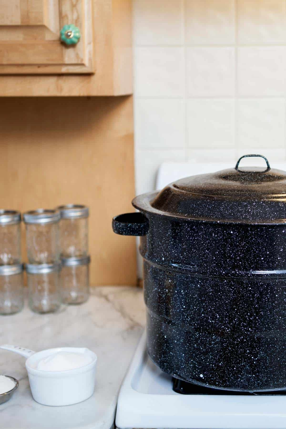 canning pot, jars, and other supplies in kitchen