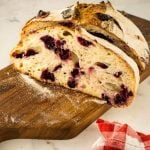 sliced loaf of sourdough bread with blueberries added
