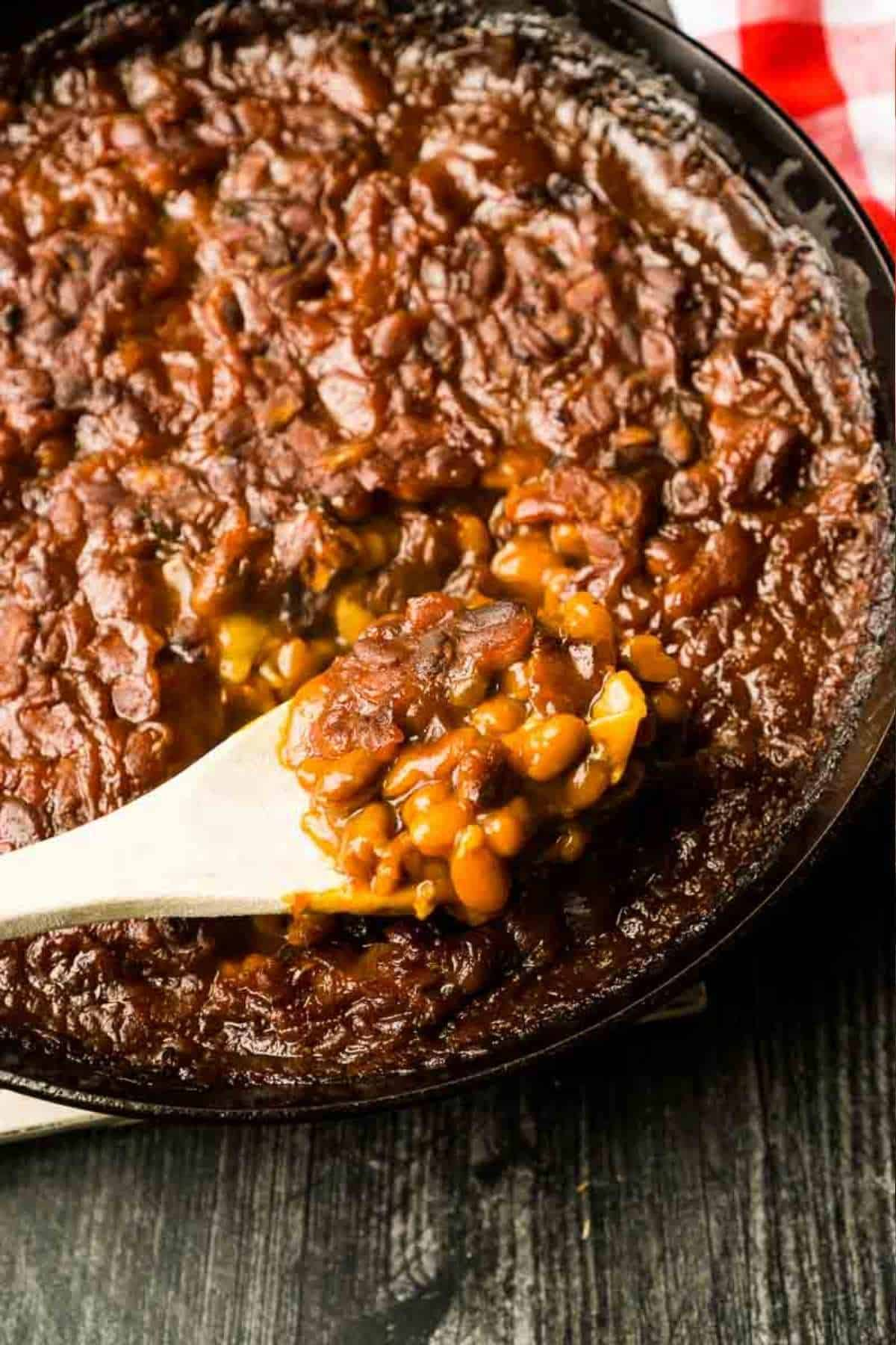 scoop of baked beans in cast iron skillet