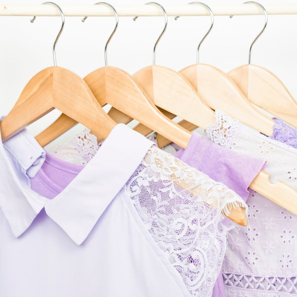 tidy closet with purple clothes on hangers