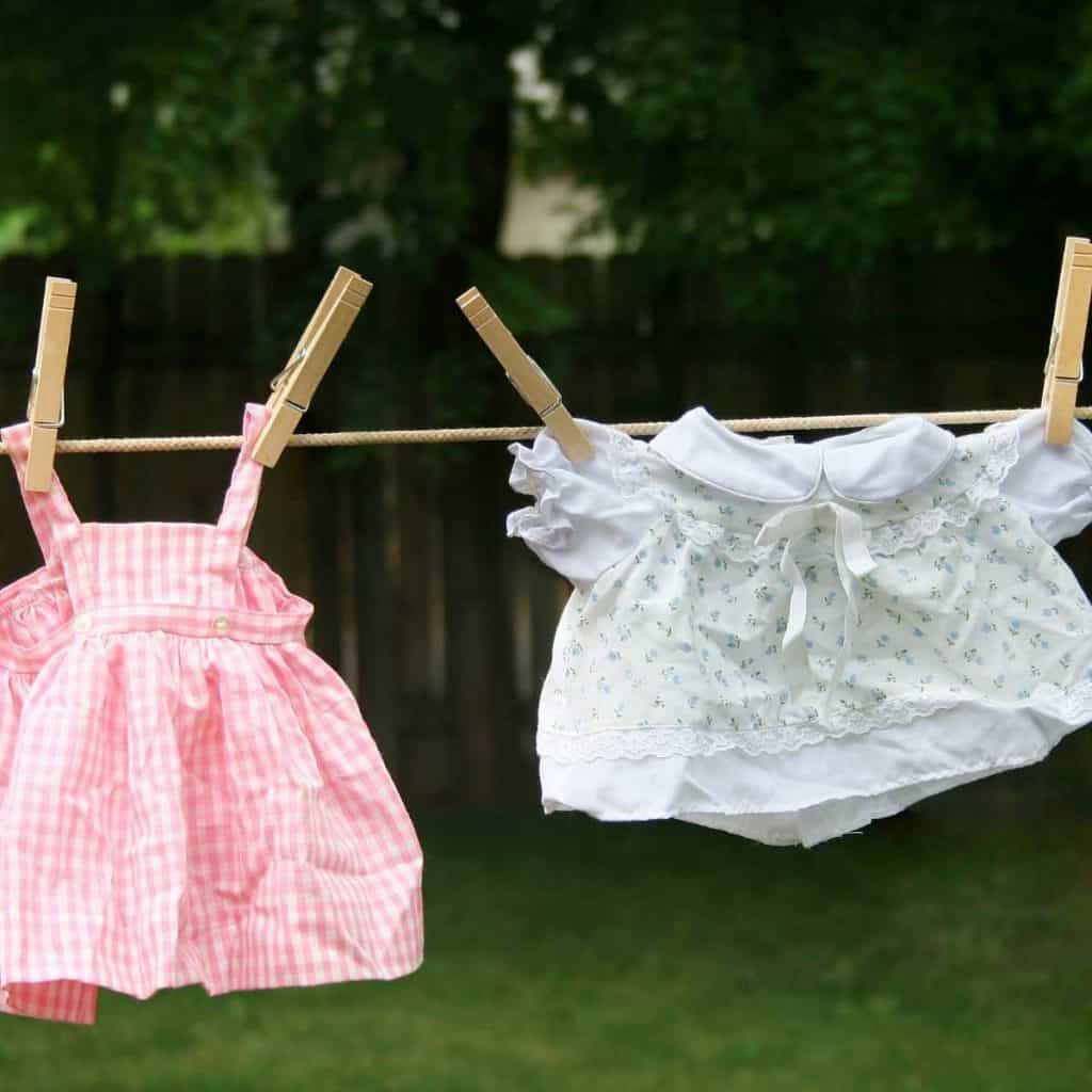 baby clothes on clothesline in spring
