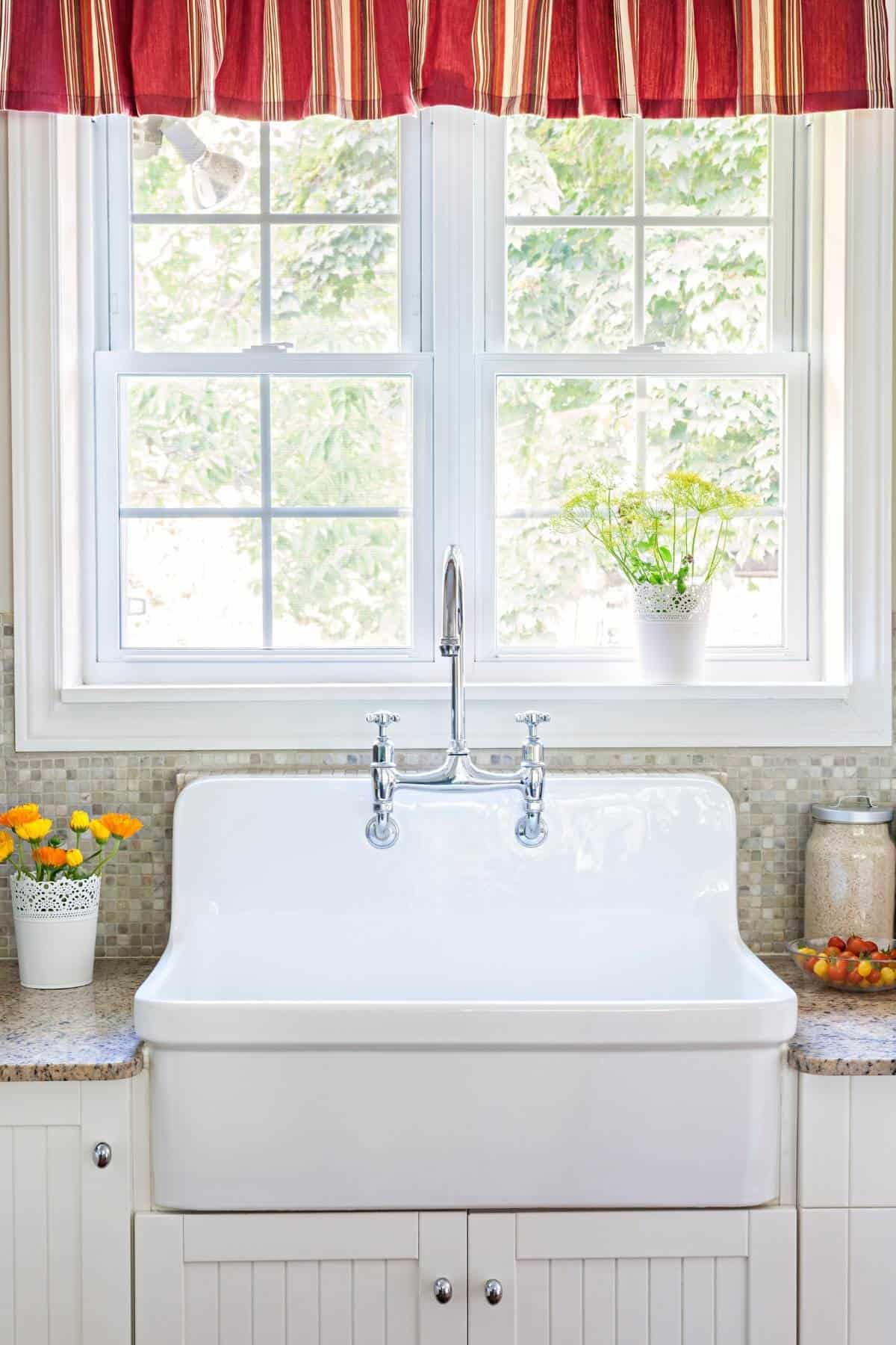 clean country style kitchen with farmhouse sink