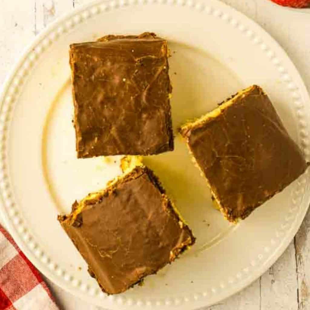 three squares of chocolate frosted cake