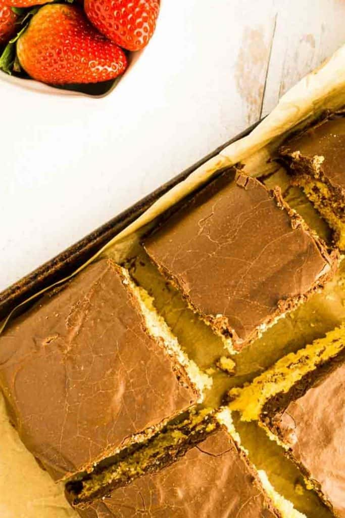 farrmer's daughter cake cut into squares on baking tin