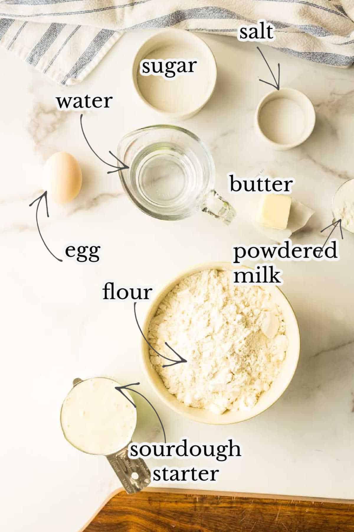 flour, sourdough starter, powdered milk, salt, sugar, and butter