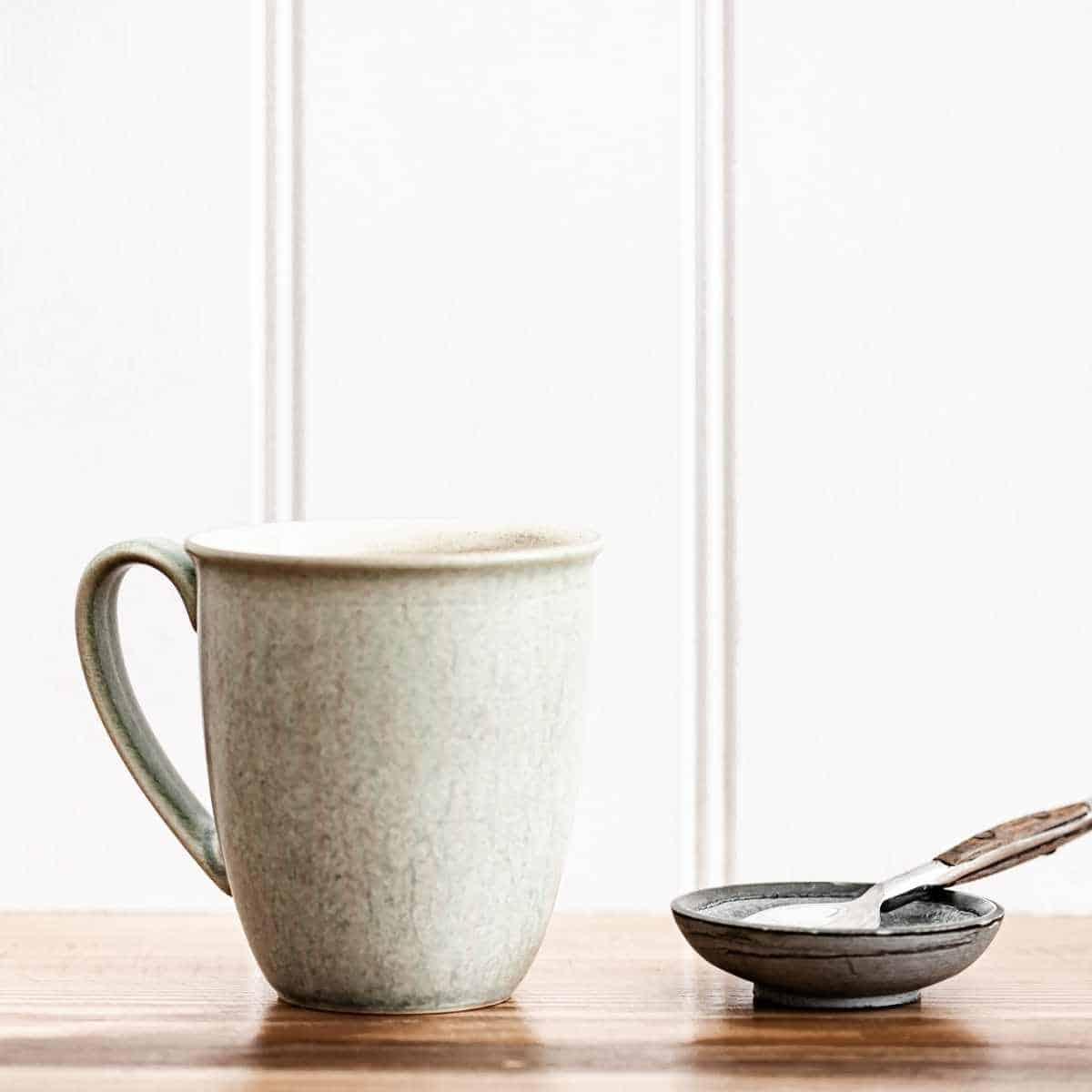 vintage mug on wooden board