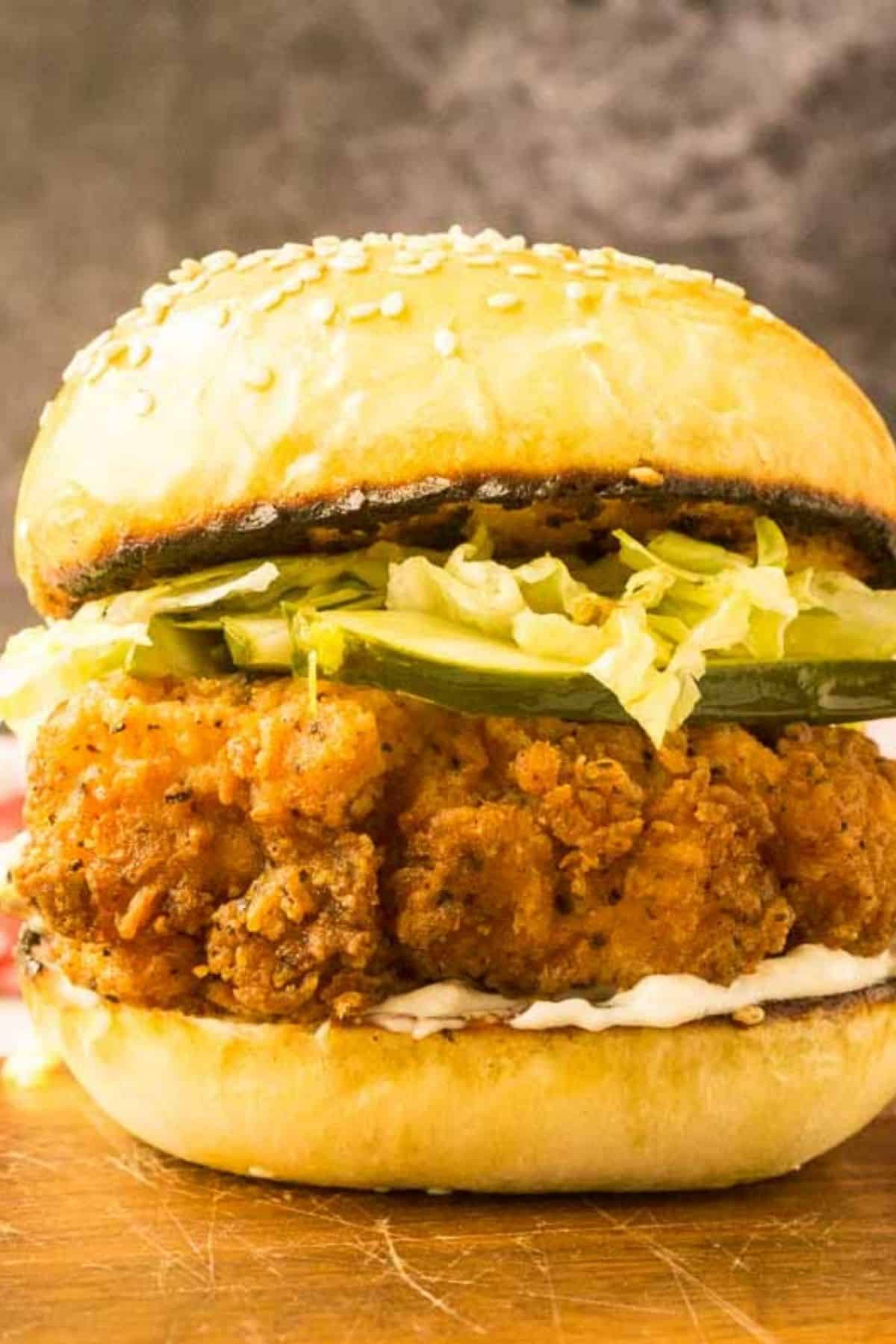 fried chicken sandwich with pickle and lettuce