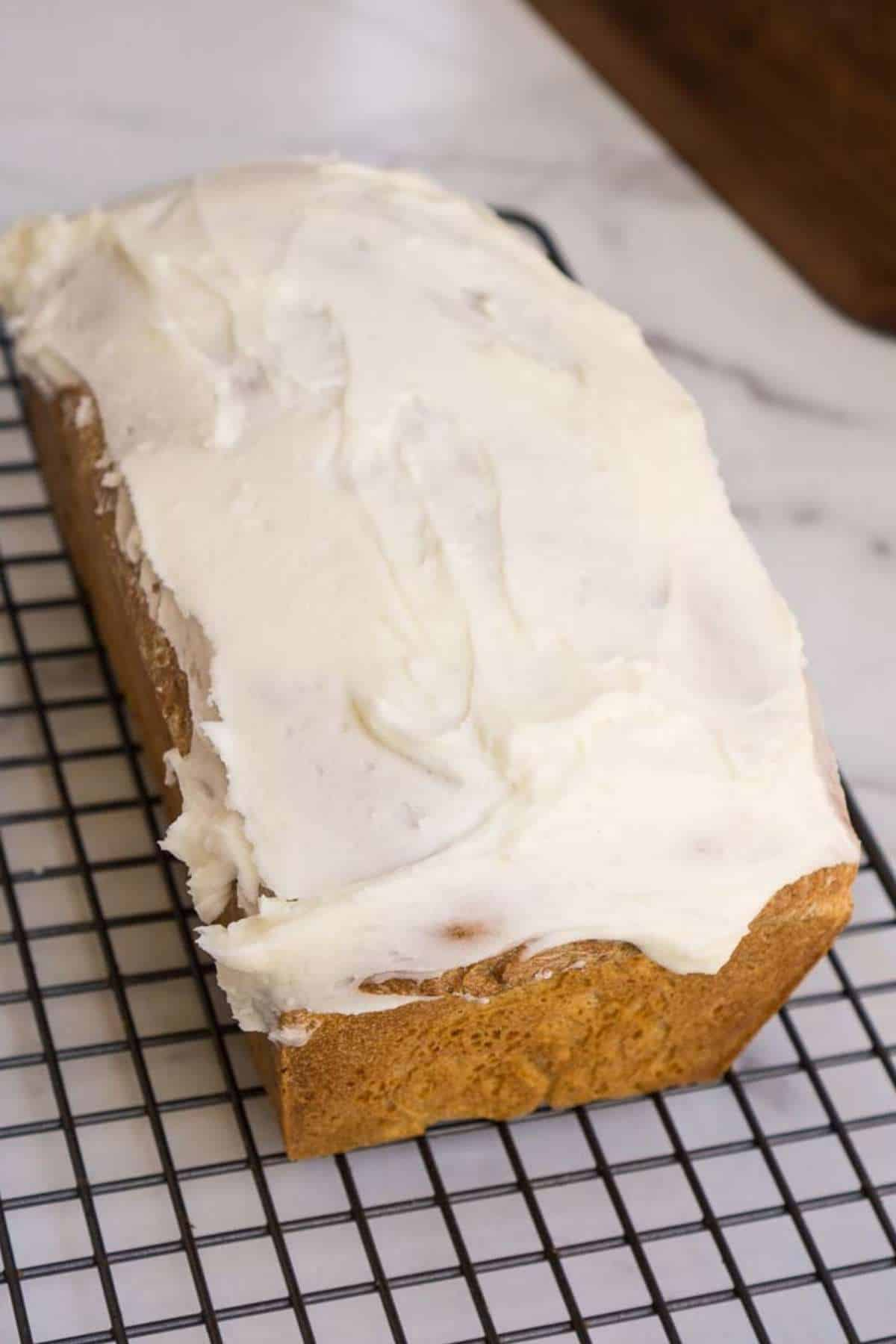 loaf of amish raisin bread with icing