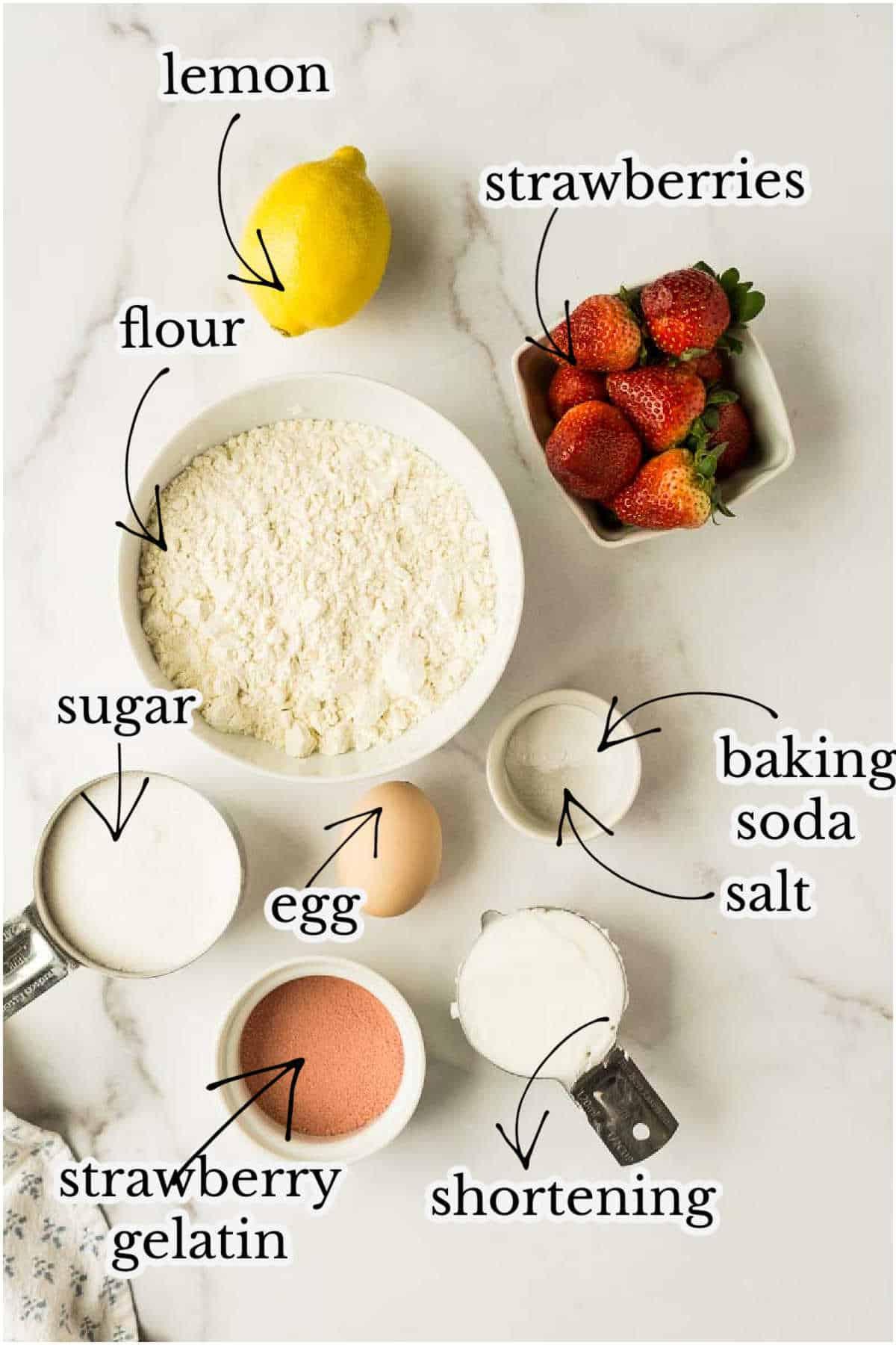 shortening, strawberries, lemon, baking soda, flour, egg, on marble counter