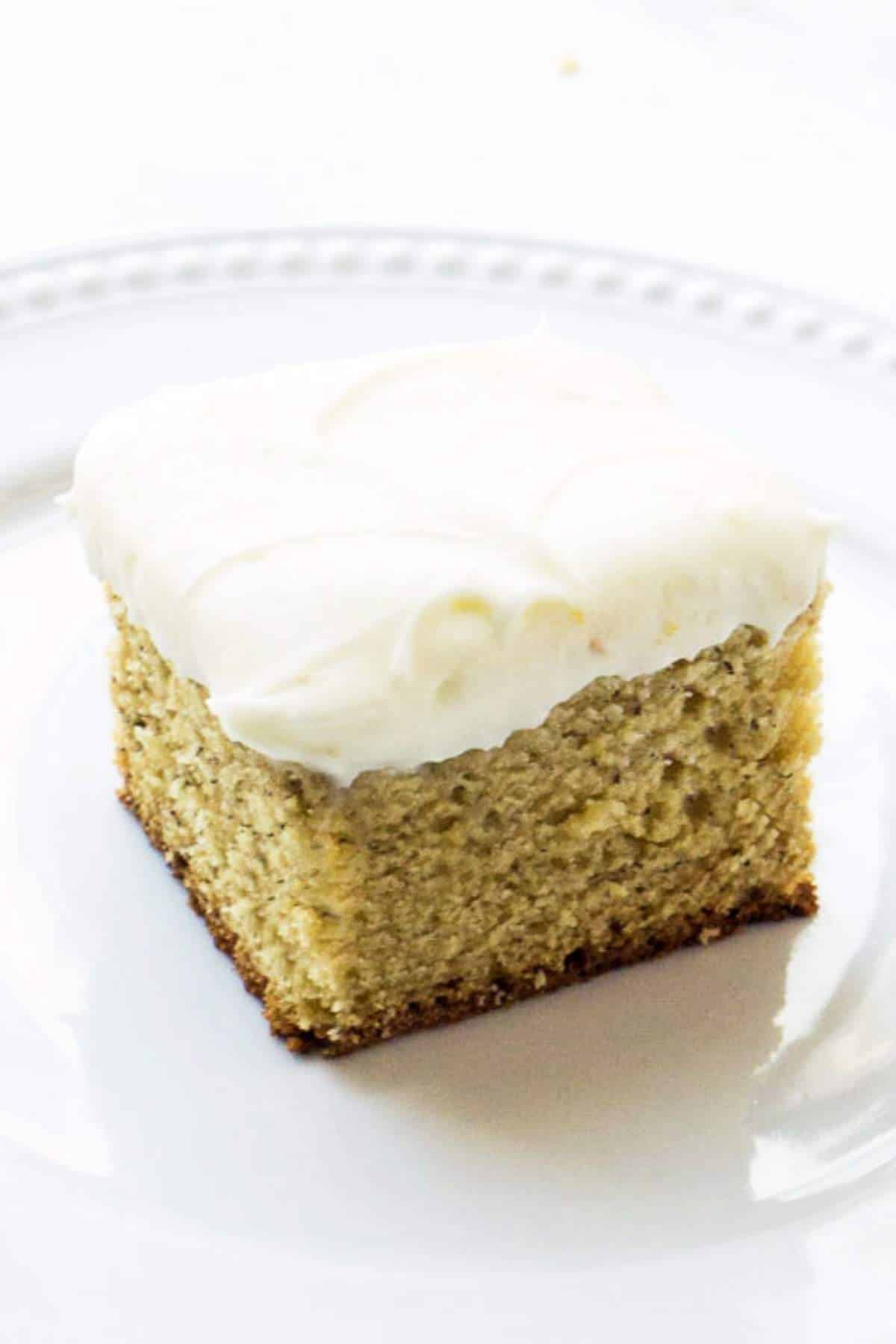 square slice of sourdough banana cake with cream cheese frosting