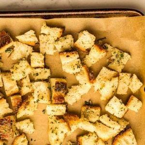 finished sourdough croutons on baking sheet