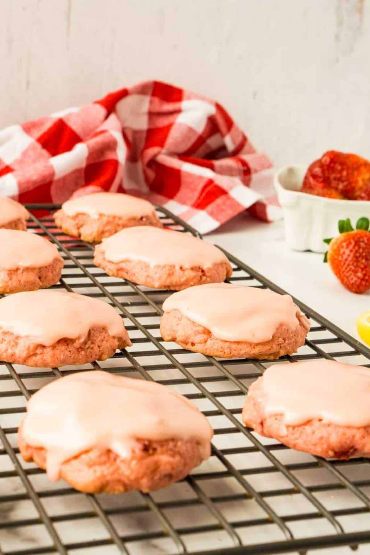 close up view of drop cookies with pink strawberry and lemon zest icing