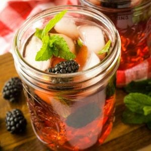 close up view of glass of blackberry sweet tea