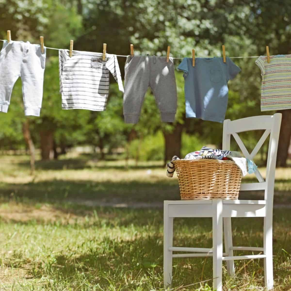 outdoor clothesline, chair in front with laundry basket