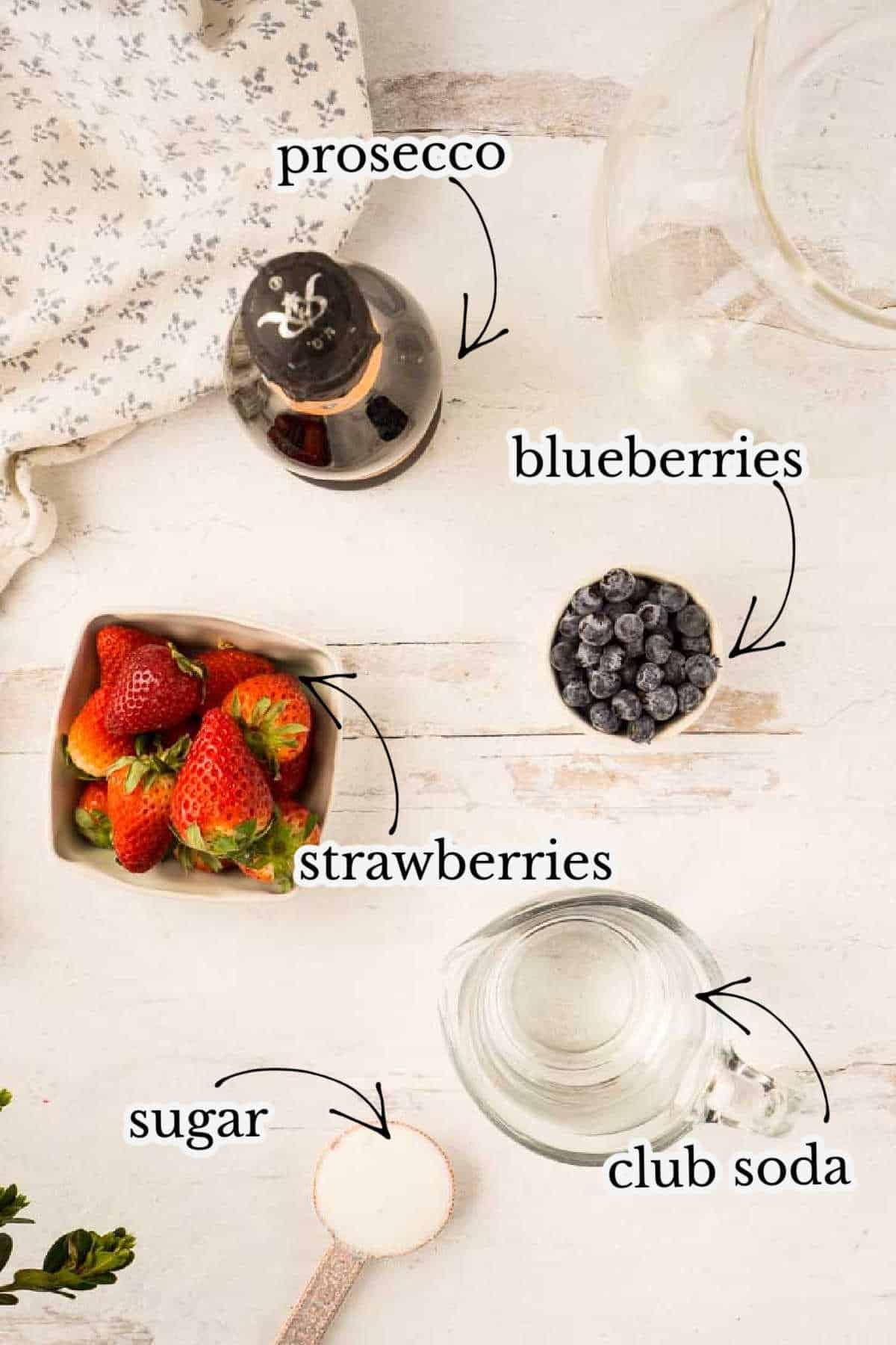prosecco, blueberries, strawberries, club soda, and sugar