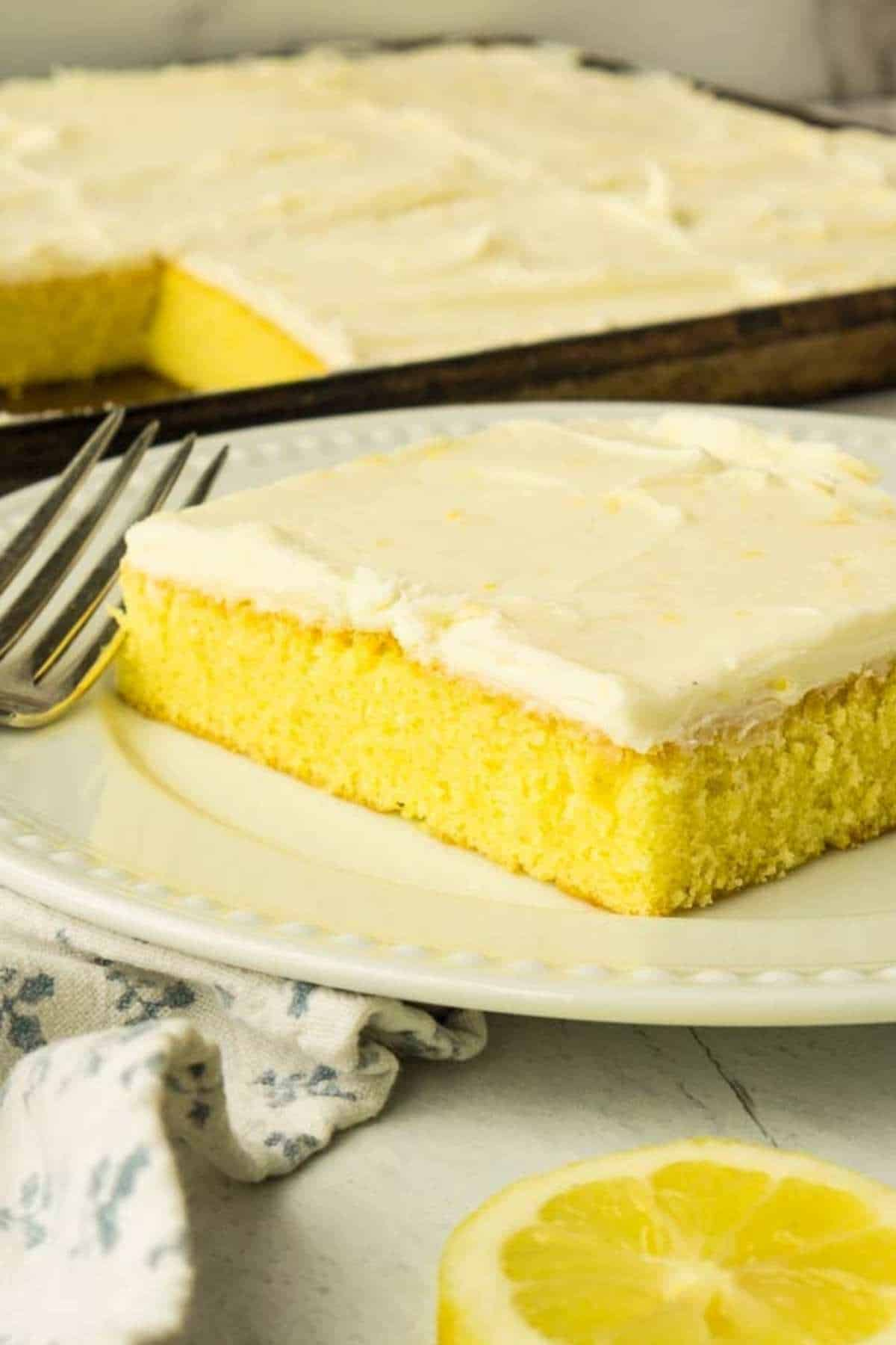 square piece of lemon sheet cake on white plate