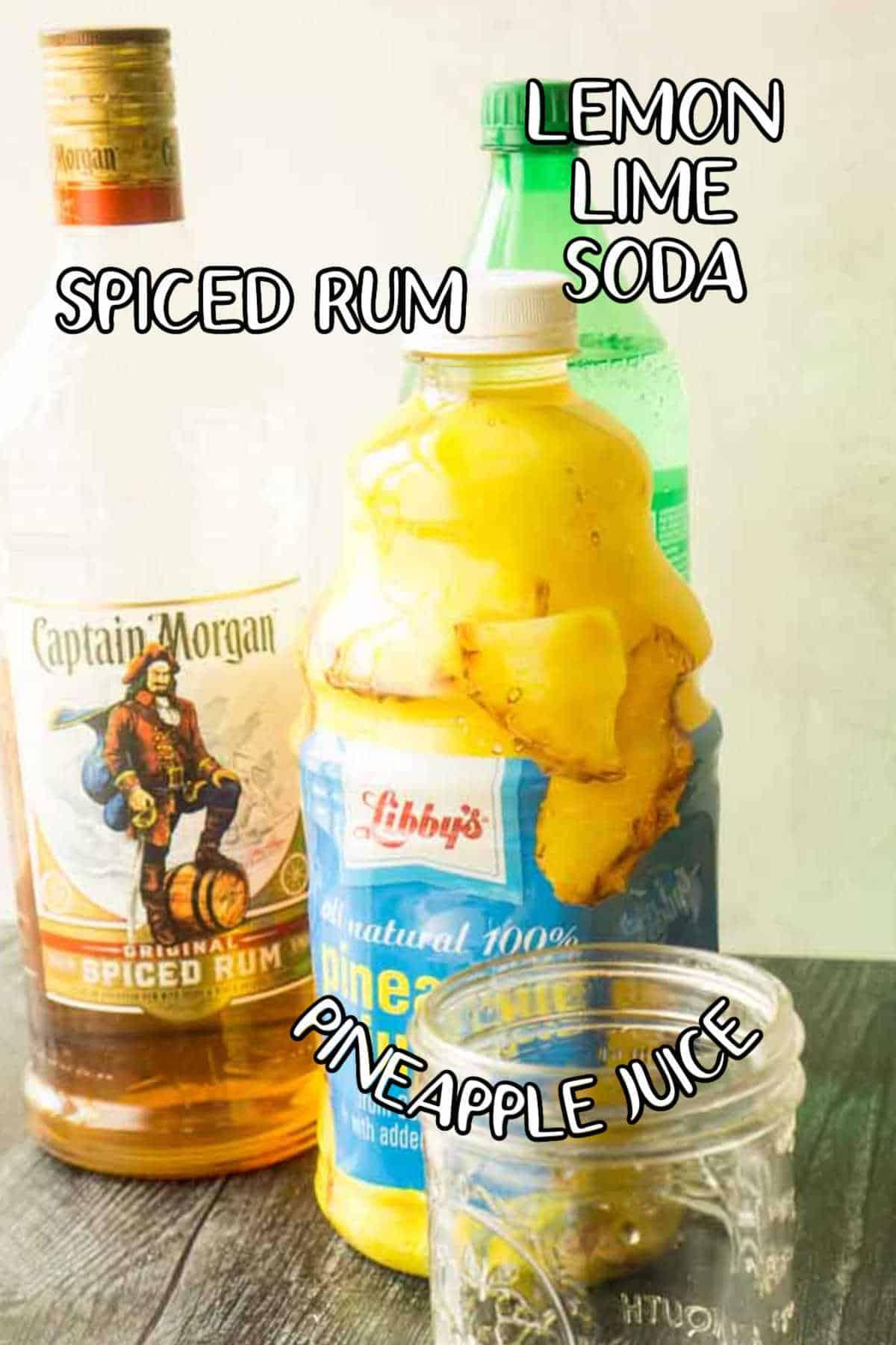 bottles of spiced rum, bottled pineapple juice, and sprite