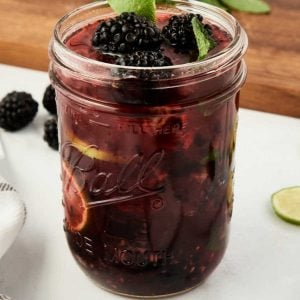blackberry mojito in mason jar with fresh lime wedge