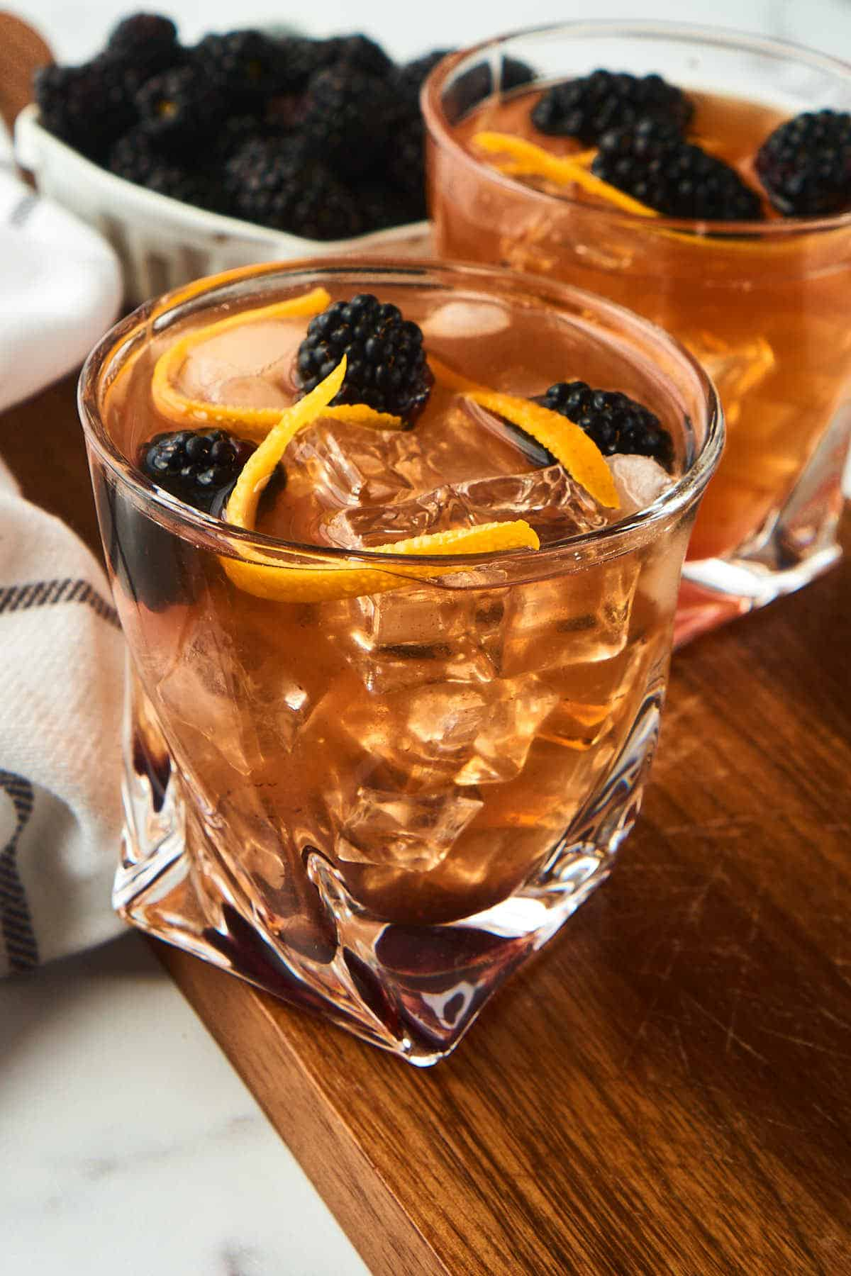 blackberry old fashioned cocktaill in rocks glass