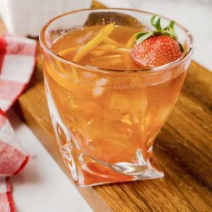 old fashioned with ice and fresh strawberry on top