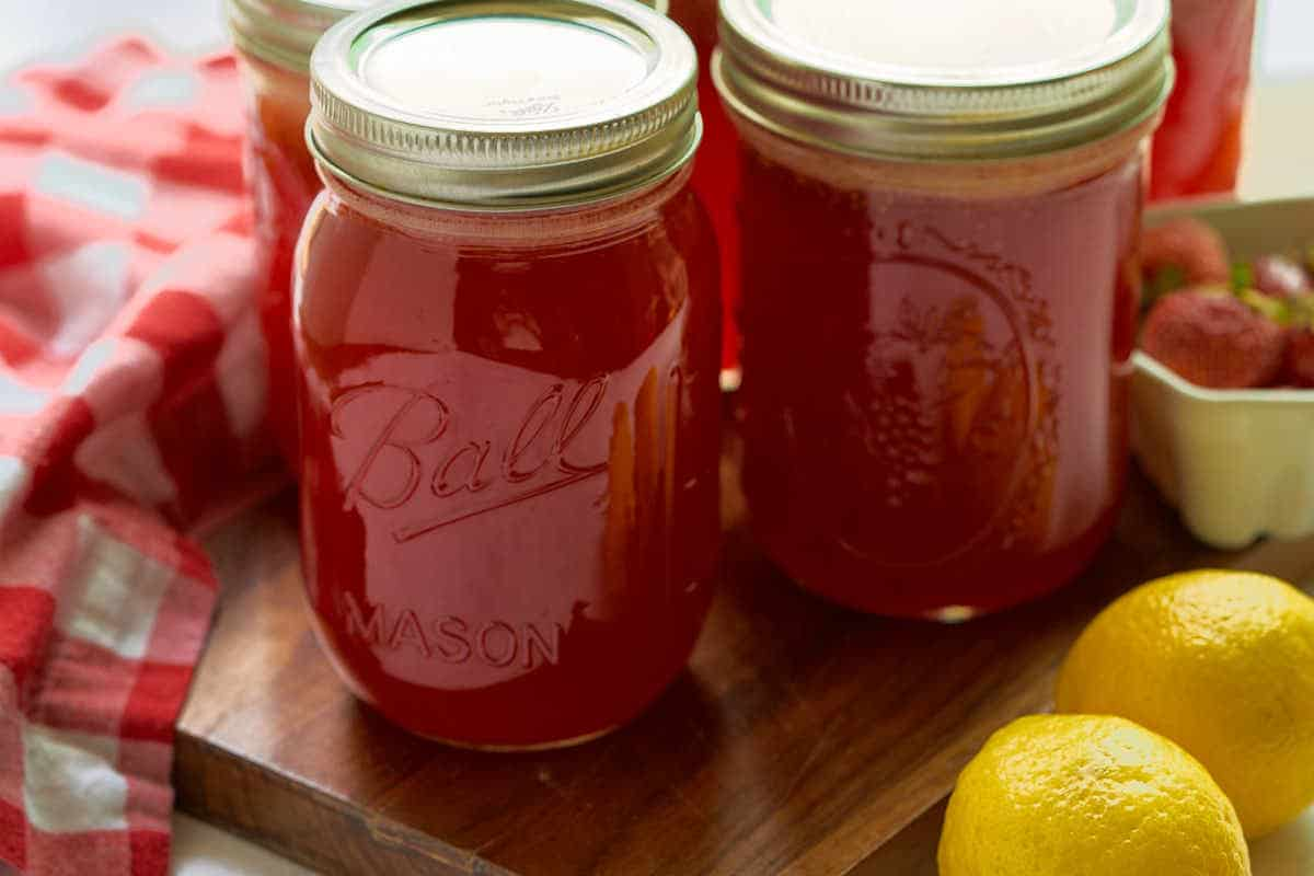 2 pint jars with bright red strawberry lemonade concentrate
