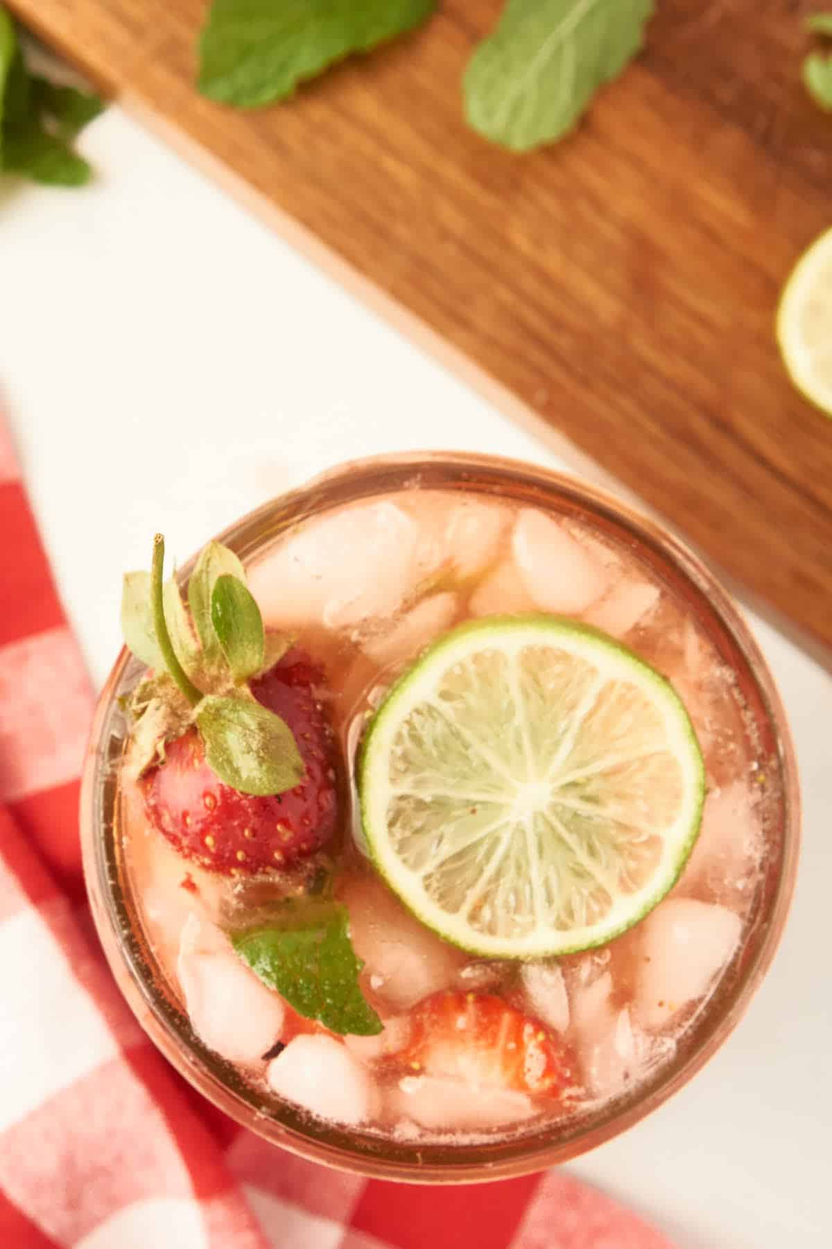 overhead view of strawberry mojito on ice