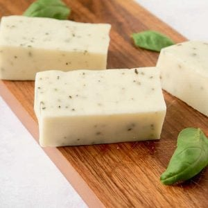 3 bars basil soap on cutting board