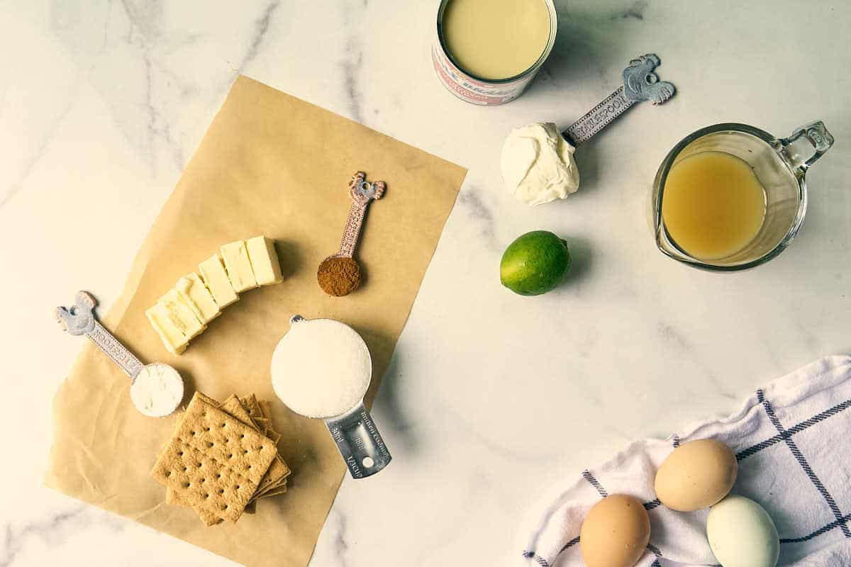 key lime juice, sweetened condensed milk, graham crackers, on marble counter