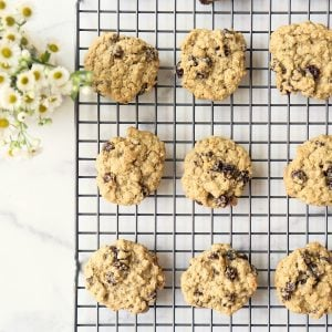 9 homemade oatmeal cookies next to white flowers