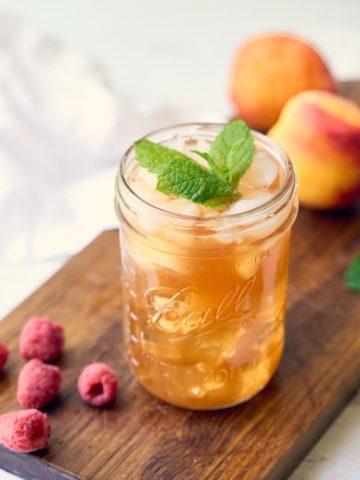 wide mouth mason jar with peach iced tea