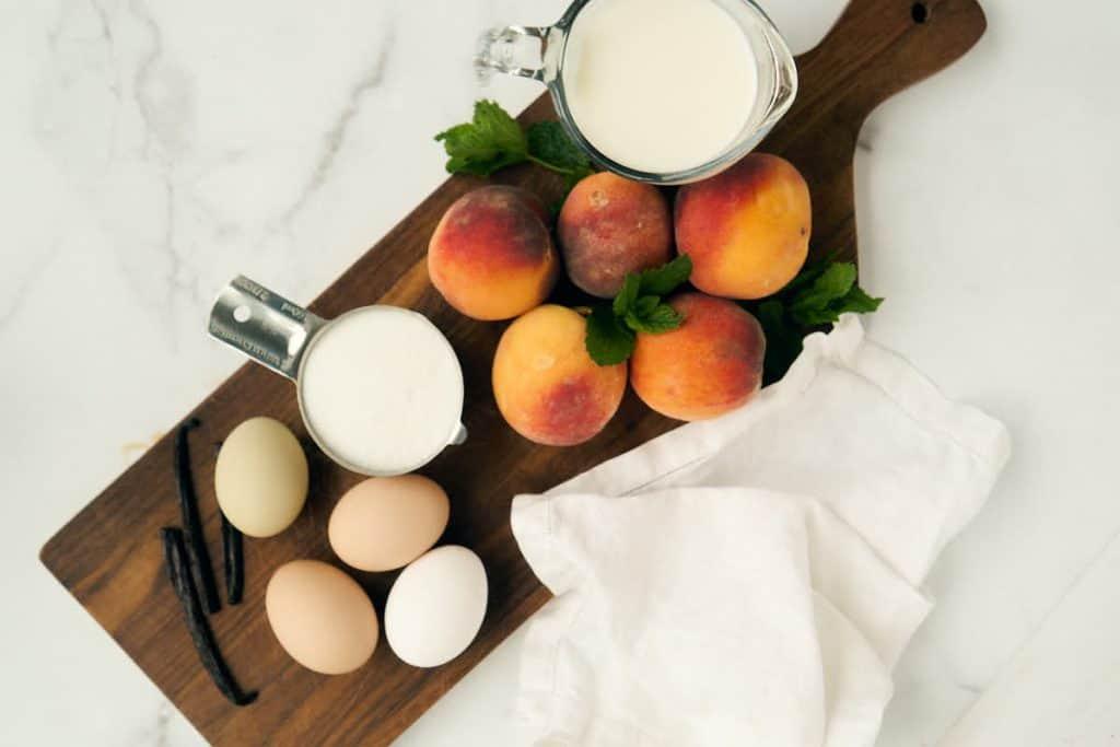 fresh peaches, cream, eggs, and vanilla beans