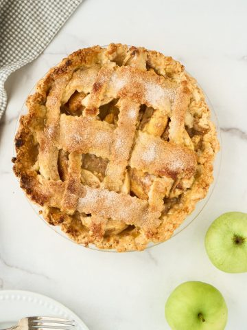 apple peach pie on marble counter