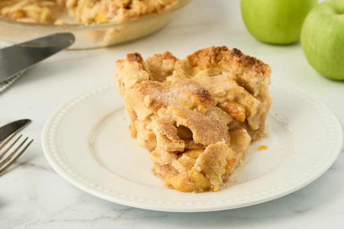 slice of apple peach pie on white plate