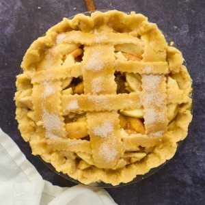 lattice topped pie with cinnamon sugar on top