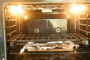 oven with two racks, lower linned in foil