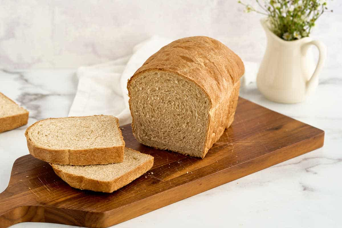 sandwich loaf of honey wheat bread, cut side facing out