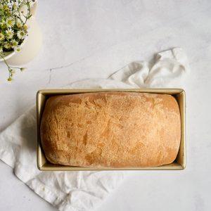 baked loaf of sandwich bread in pan