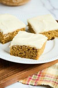 3 square pieces of sourdough pumpkin cake on white plate