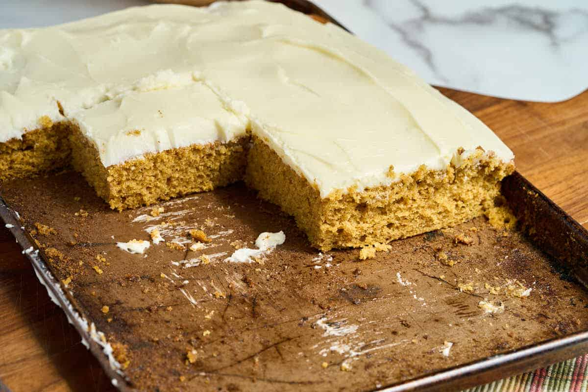 sheet pan with slices of pumpkin cake cut out
