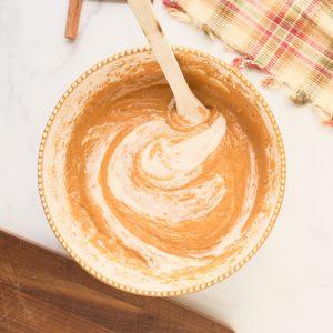 sourdouugh starter being mixed into pumpkin cake