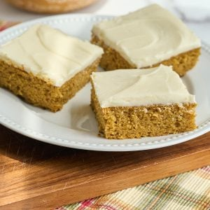 square of pumpkin cake on wooden surface
