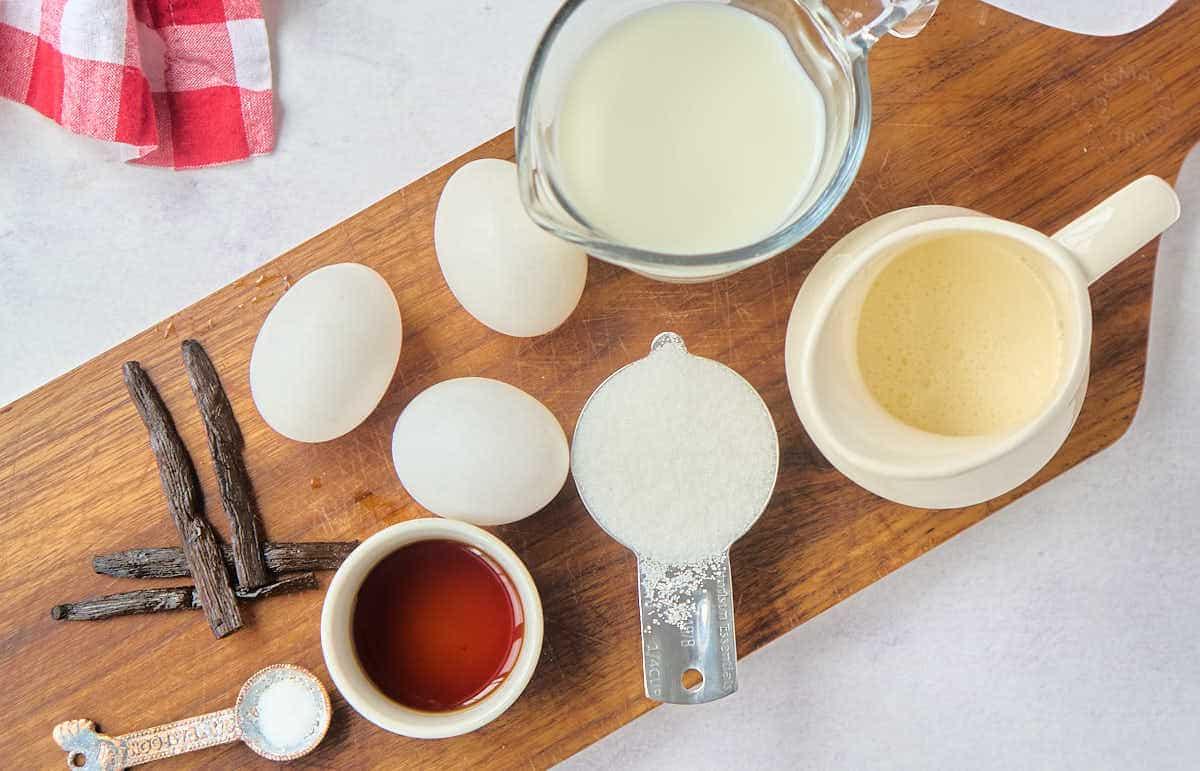cream, milk, sugar eggs vanilla bean on countertop