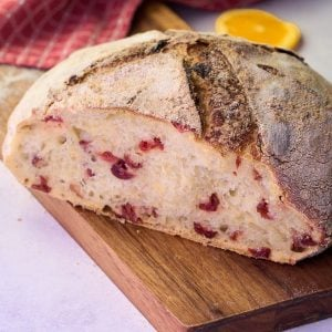 round loaf of sourdough with orange and cranberry